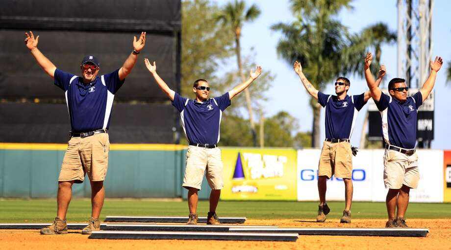 "The Detroit grounds crew performs to ""YMCA"" between innings. Photo: Karen Warren, Houston Chronicle"