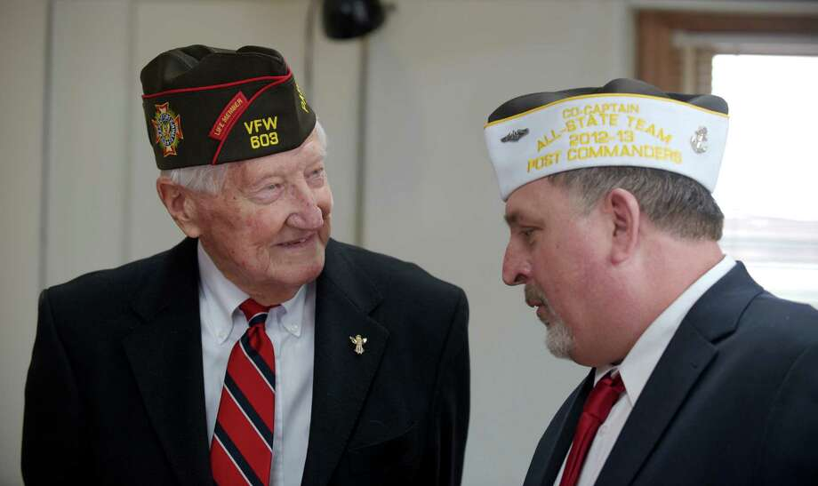 Edward Zamm,left, of Norwalk speaks to James Rebman, of Newtown,  the Post Commander of Post 308, during the Newtown, Conn, Veterans of Foreign War (VFW) Post 308 celebration of its 75th Anniversary on Sunday, March 2, 2014. Zamm is a World War II Army veteran and past VFW State Commander. Rebman served in the Navy. Photo: H John Voorhees III / The News-Times Freelance
