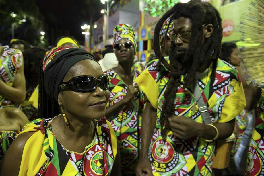 Revellers take part in the street carnival in Salvador, northeastern Brazil, on March 2, 2014.  Photo: AFP, Getty Images / 2014 AFP