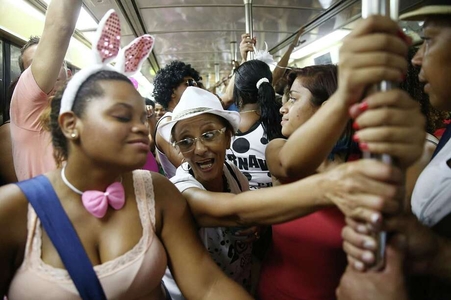 Revelers ride the subway before the 'Cordao do Prata Preta' street carnival bloco on March 1, 2014 in Rio de Janeiro, Brazil. Carnival is the grandest holiday in Brazil, annually drawing millions in raucous celebrations. Photo: Mario Tama, Getty Images / 2014 Getty Images
