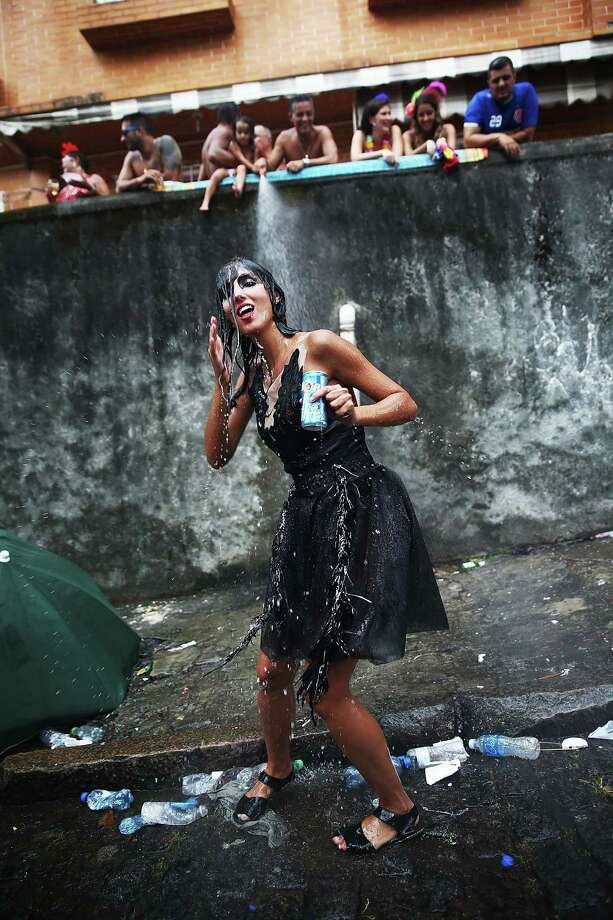 A reveler dances during the 'Ceu na Terra' street carnival bloco on March 1, 2014 in Rio de Janeiro, Brazil. Carnival is the grandest holiday in Brazil, annually drawing millions in raucous celebrations. Photo: Mario Tama, Getty Images / 2014 Getty Images