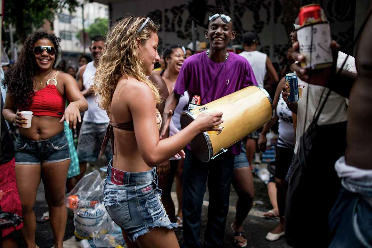 People attend the 'Cordao da Bola Preta' traditional street carnival parade at Rio Branco avenue on March 01, 2014 in Rio de Janeiro, Brazil.