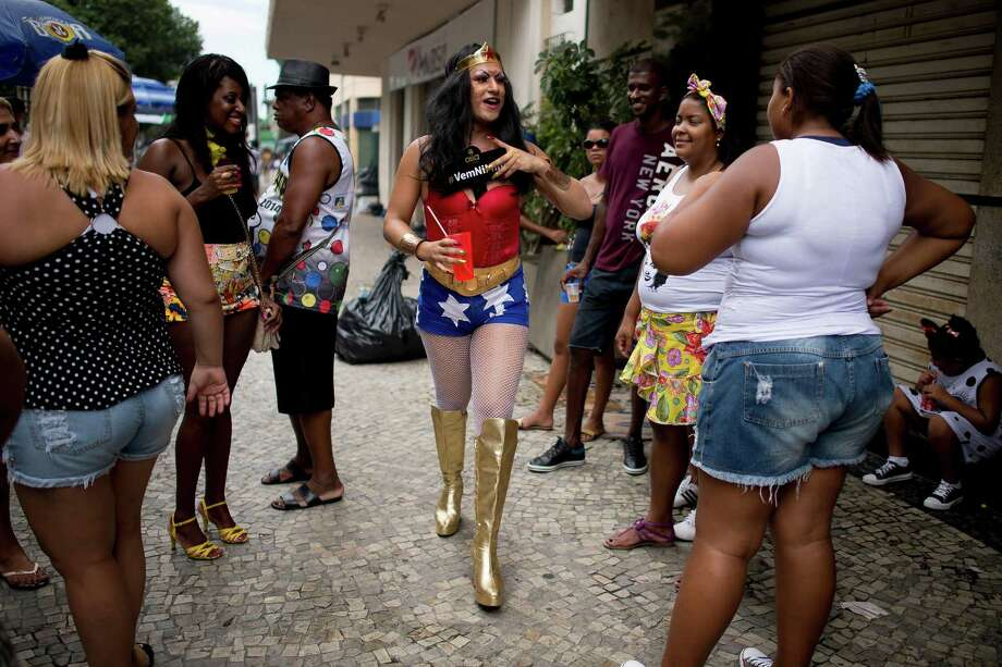 People attend the 'Cordao da Bola Preta' traditional street carnival parade at Rio Branco avenue on March 01, 2014 in Rio de Janeiro, Brazil. Photo: Buda Mendes, Getty Images / 2014 Getty Images