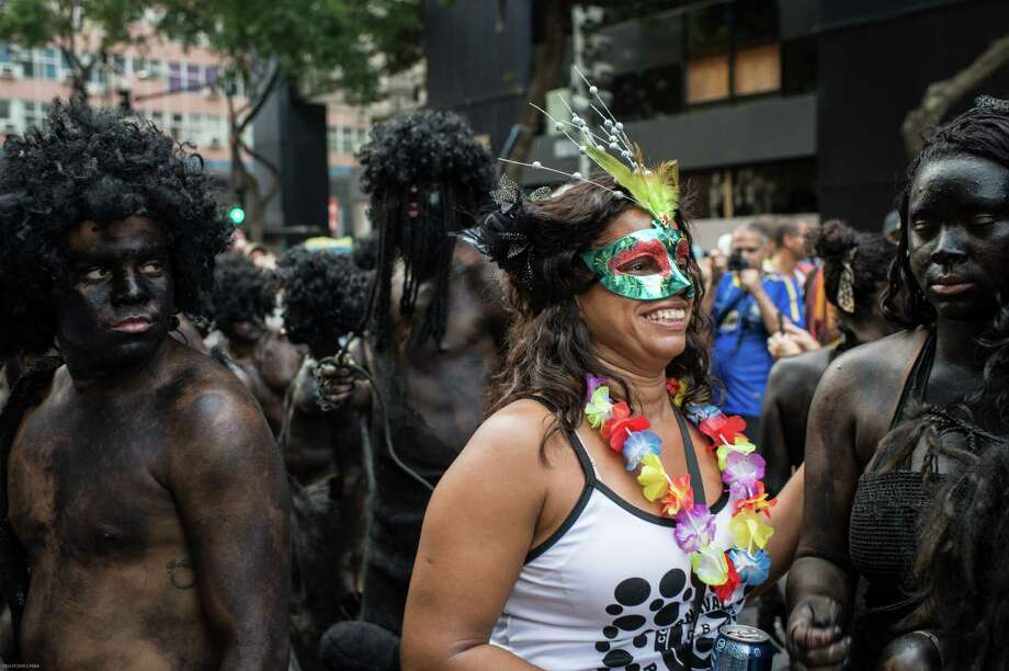 """Revellers take part in the """"Cordao da Bola Preta"""" biggest street carnival band parade in downtown Rio de Janeiro, Brazil, on March 1, 2014. Rio de Janeiro, the so called """"Marvelous city"""" is in a nonstop carnival partying. Some 1.3 million people took part in the parade, according to Riotur Rio de Janeiro's city authority. Photo: YASUYOSHI CHIBA, Getty Images / 2014 AFP"""