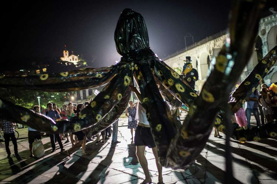 A large scale octopus puppet is operated during collective movement of occupying carnival  in Rio de Janeiro, Brazil, on Februrary 27, 2014. Rio's carnival will start officially from tomorrow for 5 days and have around 470 groups on streets. Samba school parades will have a peak at Sambodromo on March 2 and 3, 2014. Photo: YASUYOSHI CHIBA, Getty Images / 2014 AFP
