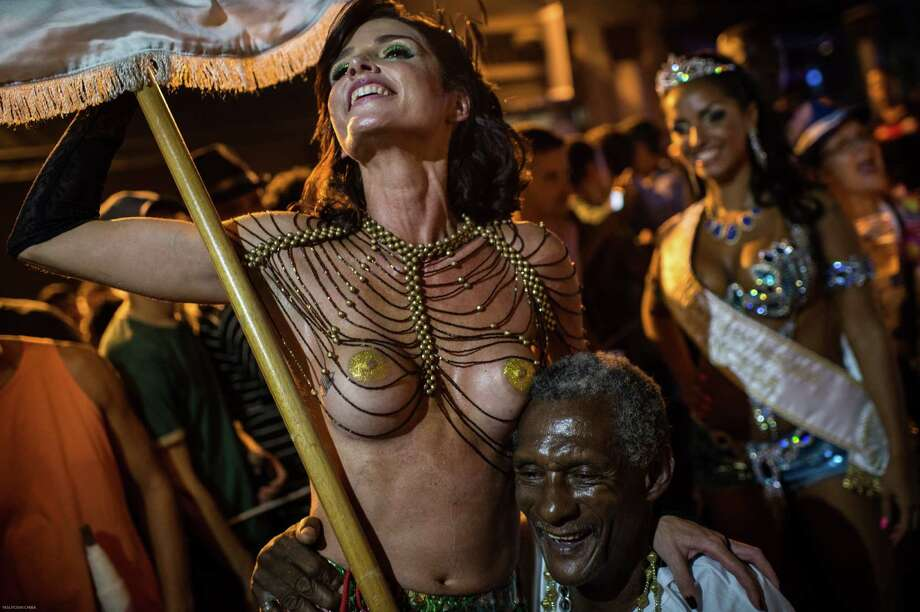 Brazilian film-maker Ana Paulo Goncalves performs in topless during a street parade of Banda da Rua do Mercado in Rio de Janeiro, Brazil, on Februrary 27, 2014. Rio's carnival will start officially from tomorrow for 5 days and have around 470 groups on the streets. Samba school parades will have a peak at Sambodromo on March 2 and 3, 2014.  Photo: AFP, Getty Images / 2014 AFP
