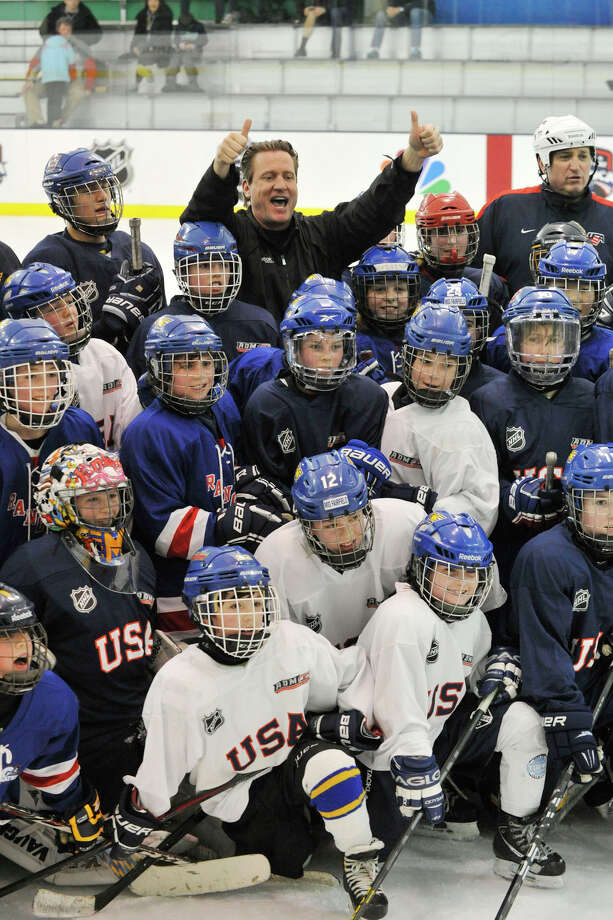 Jeremy Roenick, former NHL player and current NBC commentator, poses with children at the end of the fourth annual Hockey Day in America at Chelsea Piers in Stamford, Conn., on Sunday, March 2, 2014. Photo: Jason Rearick / Stamford Advocate