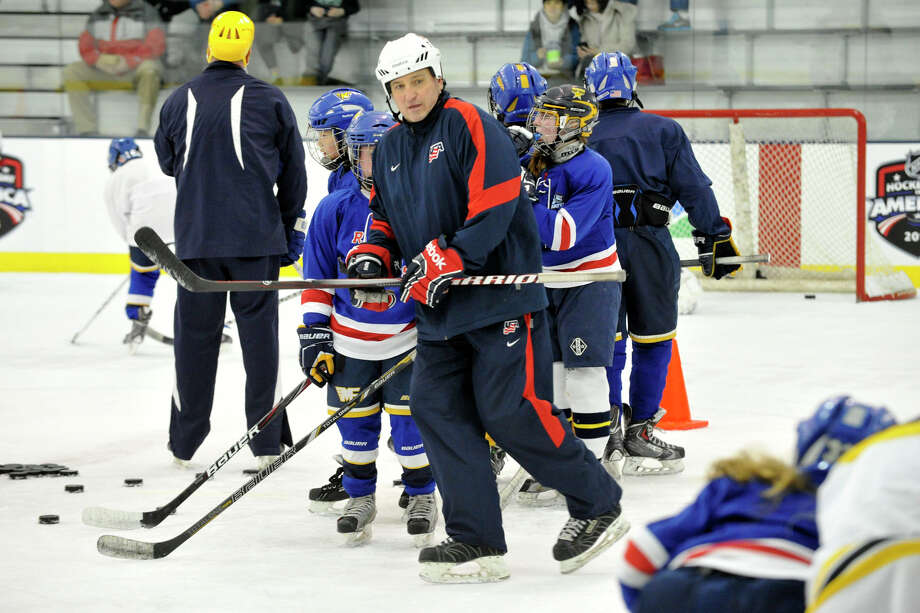 Roger Grillo, USA Hockey's New England American development model manager, watches young hockey players do hockey drills during the fourth annual Hockey Day in America at Chelsea Piers in Stamford, Conn., on Sunday, March 2, 2014. Photo: Jason Rearick / Stamford Advocate