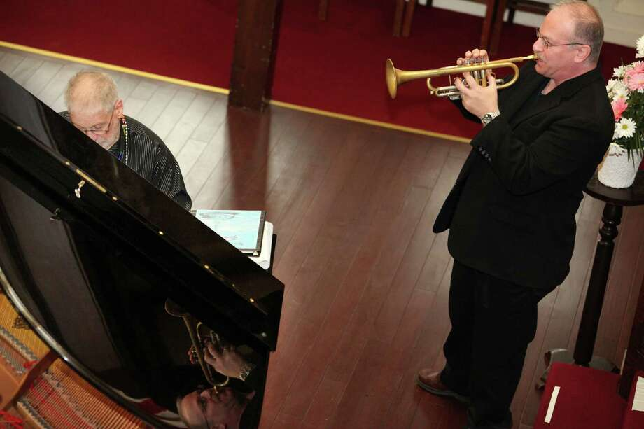 Dr Joe Utterback, left, and Joe Spitzer perform during a Fat Sunday mass at First Congregational Church in Stratford on Sunday, March 2, 2014. Photo: BK Angeletti, B.K. Angeletti / Connecticut Post freelance B.K. Angeletti