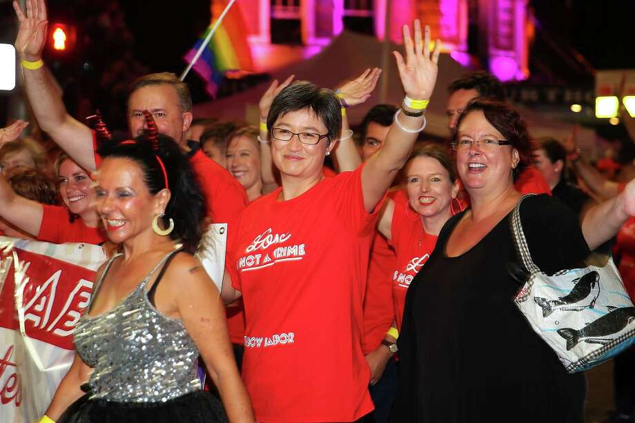 Senator, Penny Wong takes part in the 2014 Sydney Gay & Lesbian Mardi Gras Parade on March 1, 2014 in Sydney, Australia. The Sydney Mardi Gras parade began in 1978 as a march and commemoration of the 1969 Stonewall Riots of New York. It is an annual event promoting awareness of gay, lesbian, bisexual and transgender issues and themes. Photo: Brendon Thorne, Getty Images / 2014 Getty Images