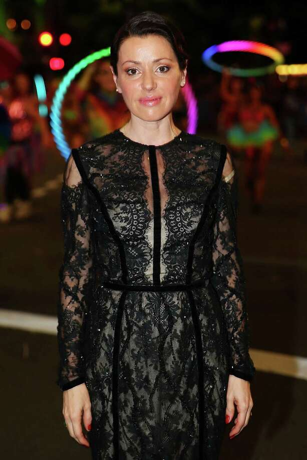 Tina Arena poses during the 2014 Sydney Gay & Lesbian Mardi Gras Parade on March 1, 2014 in Sydney, Australia. The Sydney Mardi Gras parade began in 1978 as a march and commemoration of the 1969 Stonewall Riots of New York. It is an annual event promoting awareness of gay, lesbian, bisexual and transgender issues and themes. Photo: Brendon Thorne, Getty Images / 2014 Getty Images