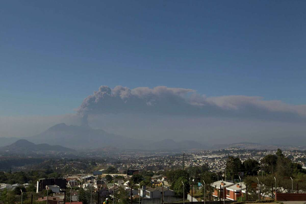 A column of ash rises from the Pacaya volcano as seen from Villa Nueva, Guatemala, Sunday, March 2, 2014. Guatemala authorities say the Pacaya volcano near Guatemala City has shot plumes of ash and vapor 2.3 miles (3.7 kilometers) high, while spewing glowing-hot rock. The eruption early Sunday is the latest round of activity at the scenic volcano located just 30 miles (50 kms) south of Guatemala City.