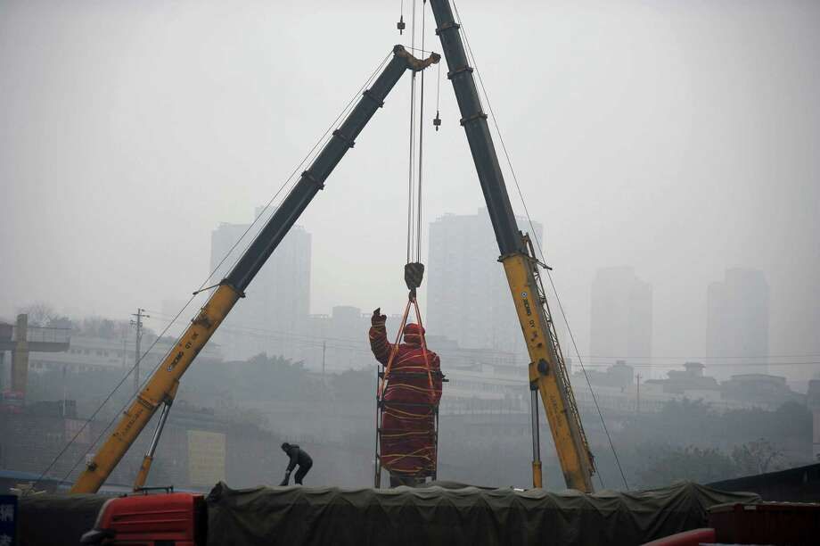 A statue of former Chinese leader Mao Zedong is prepared for removal to the Chongqing Industry Museum in southwest China's Chongqing Municipality on Tuesday Feb. 25, 2014. The sculpture was built in 1968 and erected in a state-run factory which went bankrupt later and was transformed into a logistics park. (AP Photo) Photo: Uncredited, AP / AP2014