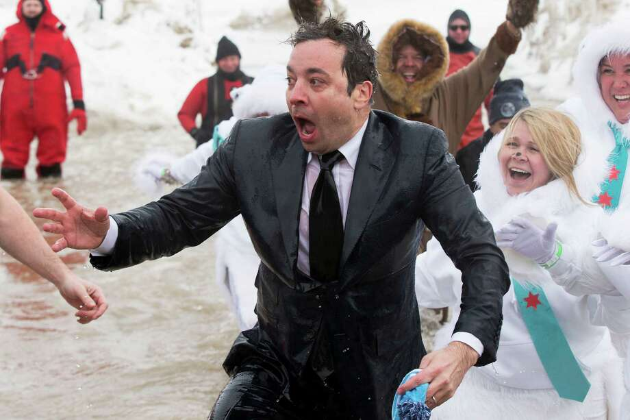 """The Tonight Show"" host Jimmy Fallon, center, exits the water during the Chicago Polar Plunge, Sunday, March 2, 2014, in Chicago. Fallon joined Chicago Mayor Rahm Emanuel in the event. Photo: Andrew Nelles, AP / AP2014"