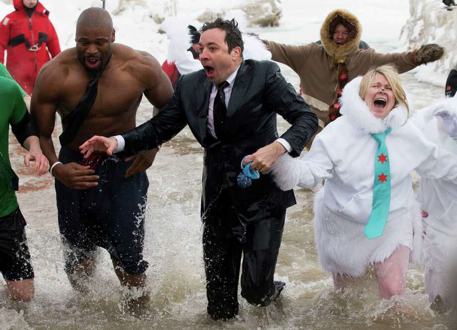 """""""The Tonight Show"""" host Jimmy Fallon, center, exits the water during the Chicago Polar Plunge, Sunday, March 2, 2014, in Chicago. Fallon joined Chicago Mayor Rahm Emanuel in the event. Photo: Andrew Nelles, AP / FR170974 AP"""