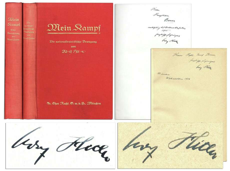 "This undated image provided by Nate D. Sanders Auction shows the Adolph Hitler inscribed ""Mein Kampf"" volume to future SS leader Joseph Bauer. The signed two-volume set of ""Mein Kampf,"" the manifesto of the future Fuhrer will be auctioned by Nate D. Sanders on Thursday, Feb. 27, 2014. Interested bidders may participate in the auction online. Both volumes are signed by Hitler and are dedicated to Josef Bauer, one of the first members of the Nazi party and one of the leaders of the Beer Hall Putsch in 1923. Photo: Uncredited, AP / AP2012"