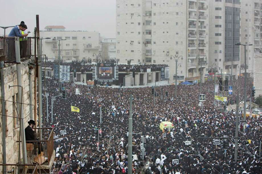 Hundreds of thousands of ultra-Orthodox Jews rally in a massive show of force against plans to force them to serve in the Israeli military, blocking roads and paralyzing the city of Jerusalem, Sunday, March 2, 2014. The widespread opposition to the compulsory draft poses a challenge to the country, which is grappling with a cultural war over the place of the ultra-Orthodox in Israeli society. With secular Jews required to serve, the issue is one of the most sensitive flashpoints between Israel's secular majority and its devout minority. Photo: Oded Balilty, AP / AP