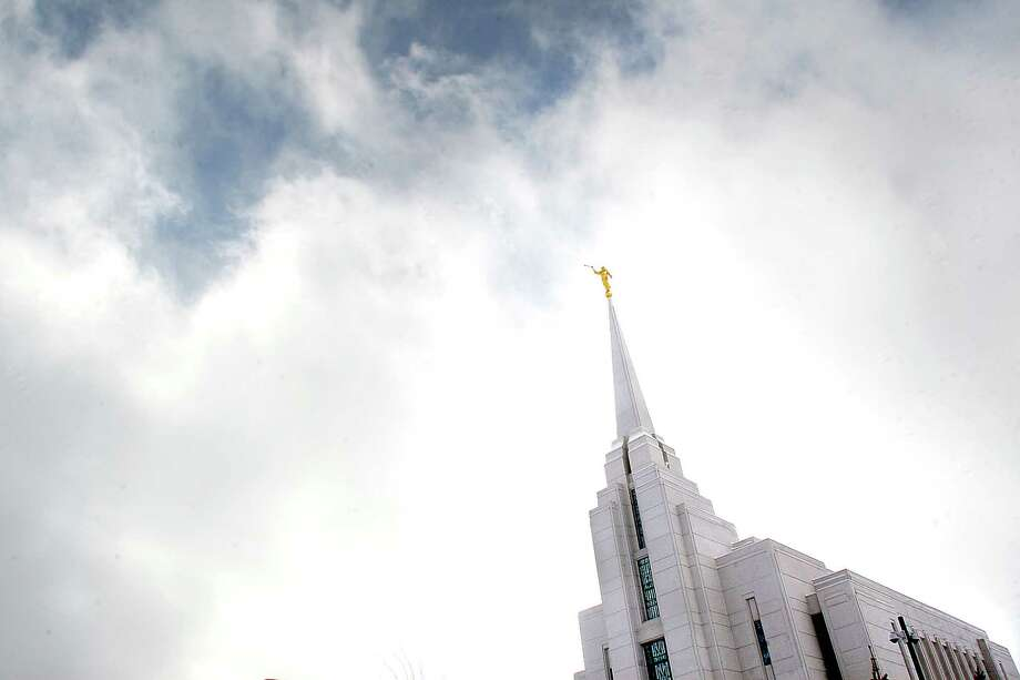 "This December, 2007, file photo, shows the Mormon Temple in Rexburg, Idaho. A newly-posted article, part of a series of recent online articles posted on the website of The Church of Jesus Christ of Latter-day Saints, affirms the Mormon faith's belief that humans can become like God in eternity, but explains that the ""cartoonish image of people receiving their own planets"" is not how the religion envisions it. Photo: Amanda Smith, AP / AP"