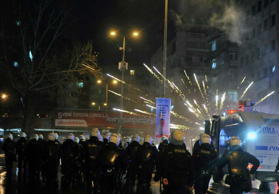"Riot police use water cannons to disperse protesters during an anti-government protest denouncing a corruption scandal that has shaken Prime Minister Recep Tayyip Erdogan's government, in Ankara, Turkey, Saturday, March 1, 2014. Protesters shouted ""there's a thief"" and ""government resign,"" a day after five remaining suspects jailed in a vast corruption investigation that has shaken Erdogan's government, including two former ministers' sons and a businessman suspected of bribery and illicit money transfers to Iran, have been released on parole pending trial. Photo: AP / AP"
