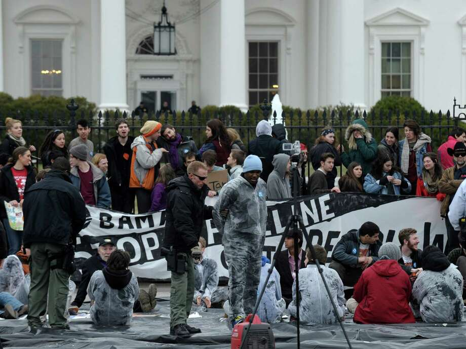 Several hundred students and youth who marched from Georgetown University to the White House to protest the Keystone XL Pipeline are arrested outside the White House in Washington, Sunday, March 2, 2014. Photo: Susan Walsh, AP / AP