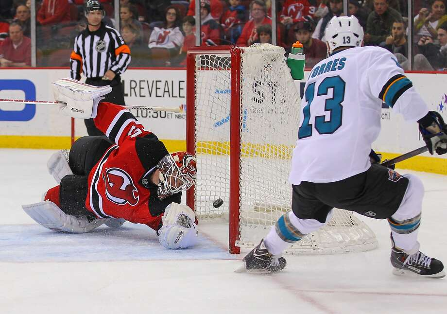 Sharks left wing Raffi Torres scores on New Jersey goalie Cory Schneider during the second period. It was Torres' third goal in three games since returning from knee surgery. Photo: Ed Mulholland, Reuters