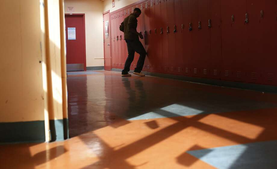 Johnny Caples, one of the 241 students at June Jordan School for Equity in San Francisco, checks his locker. Photo: Mike Kepka, The Chronicle