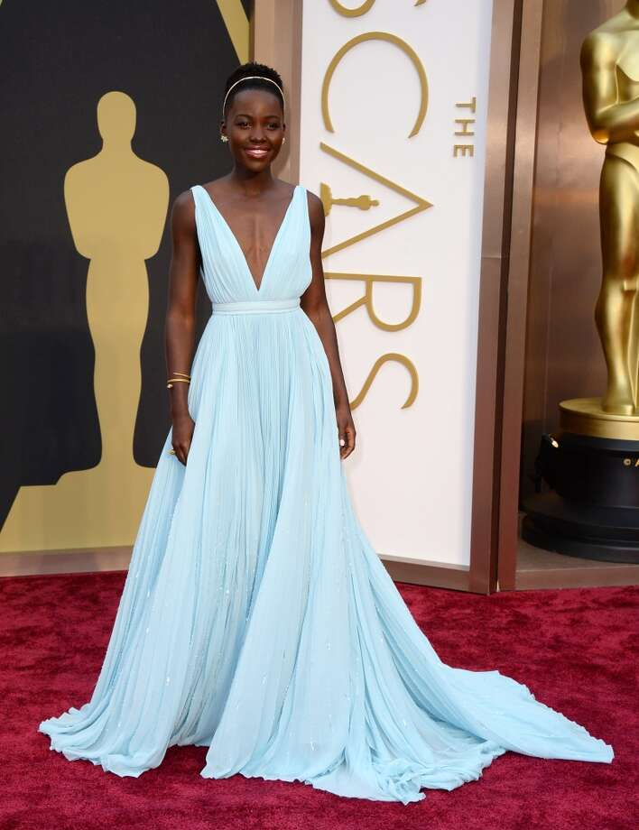 Lupita Nyong'o arrives at the Oscars on Sunday, March 2, 2014, at the Dolby Theatre in Los Angeles. Photo: Jordan Strauss, Associated Press