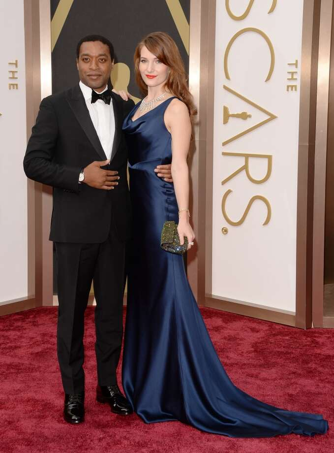 Actor Chiwetel Ejiofor (L) and Sari Mercer attends the Oscars held at Hollywood & Highland Center on March 2, 2014 in Hollywood, California. Photo: Jason Merritt, Getty Images