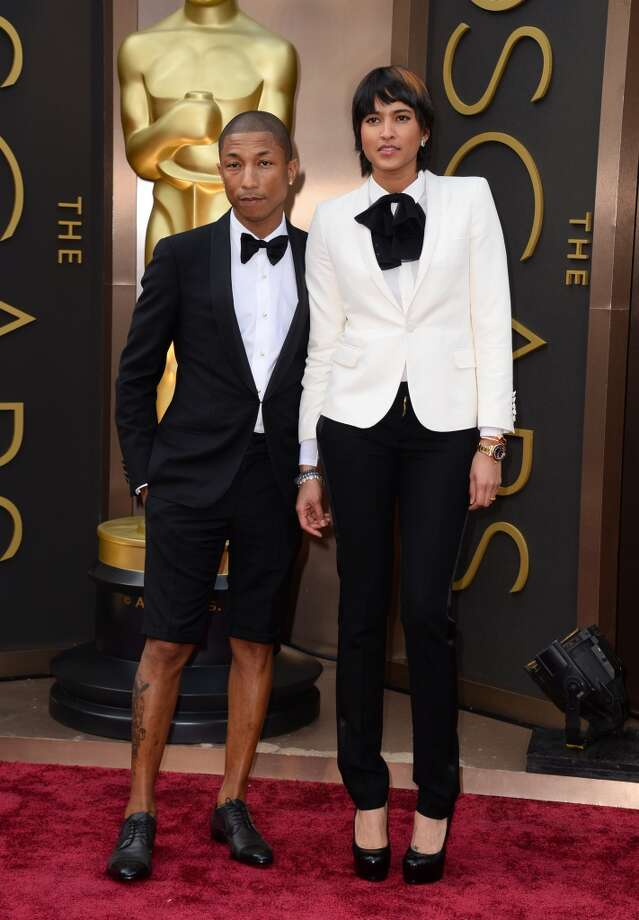 Hey, Pharrell, where's the hat?! Pharrell Williams, left, and Helen Lasichanh arrive at the Oscars on Sunday, March 2, 2014, at the Dolby Theatre in Los Angeles. Photo: Jordan Strauss, Associated Press
