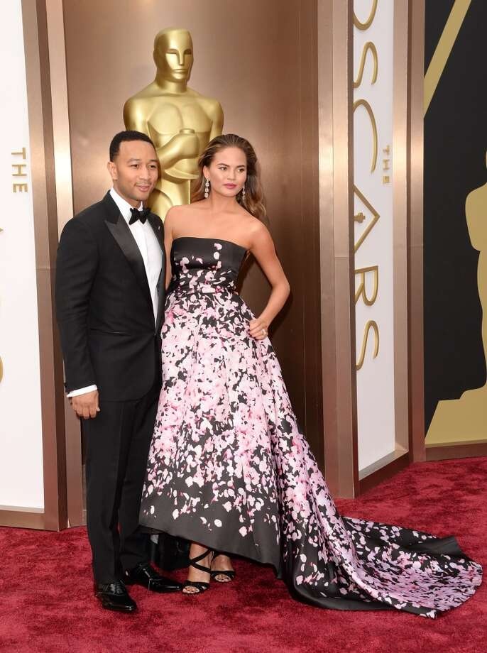 Recording artist John Legend (L) and model Christine Teigen attend the Oscars held at Hollywood & Highland Center on March 2, 2014 in Hollywood, California. Photo: Jason Merritt, Getty Images