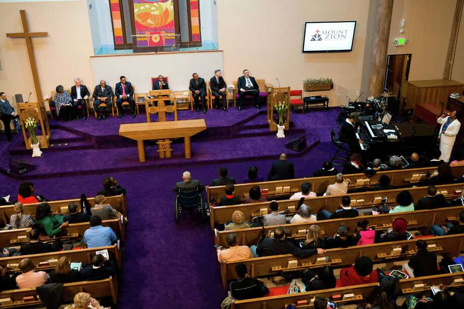Closing music begins during a ceremony to unveil the Rev. Dr. S. McKinney Avenue honorary street sign Sunday, March 2, 2014, at Mt. Zion Baptist Church in Seattle. A portion of 19th Avenue will now be known as Rev. Dr. S. McKinney Ave. Photo: JORDAN STEAD, SEATTLEPI.COM / SEATTLEPI.COM
