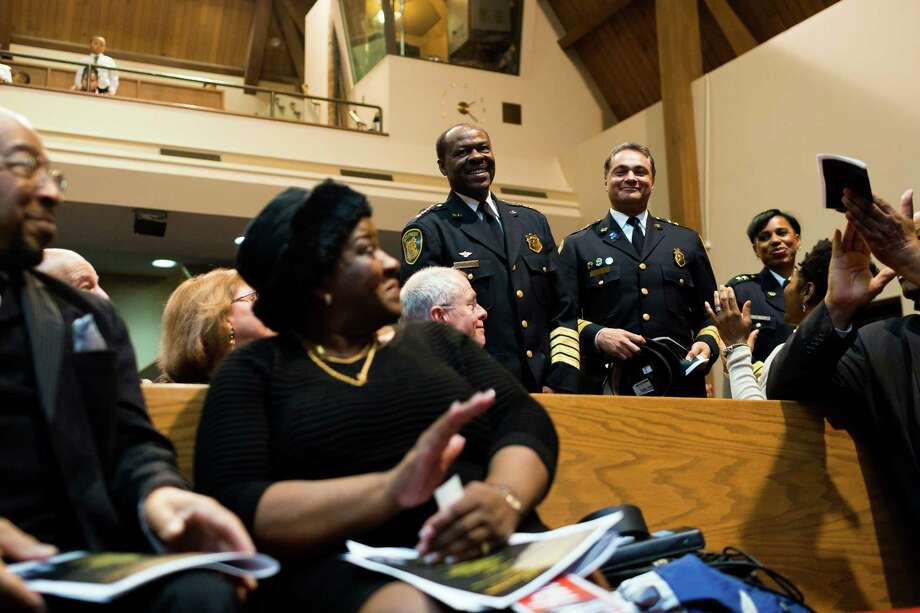 "Seattle's Chief of Police, Harry C. Bailey, center, is recognized during a ceremony to unveil the Reverend Dr. Samuel B. McKinney honorary street sign Sunday, March 2, 2014, at Mt. Zion Baptist Church in Seattle. A portion of 19th Avenue will now be known as ""Rev. Dr. S. McKinney Ave."" Photo: JORDAN STEAD, SEATTLEPI.COM / SEATTLEPI.COM"