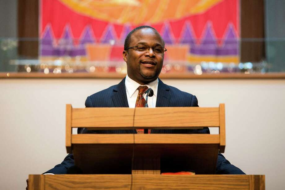Rev. Aaron Williams, of the Mount Zion Baptist Church, prepares to unveil the Rev. Dr. S. McKinney Avenue honorary street sign Sunday, March 2, 2014, at Mt. Zion Baptist Church in Seattle. A portion of 19th Avenue will now be known as Rev. Dr. S. McKinney Ave. Photo: JORDAN STEAD, SEATTLEPI.COM / SEATTLEPI.COM