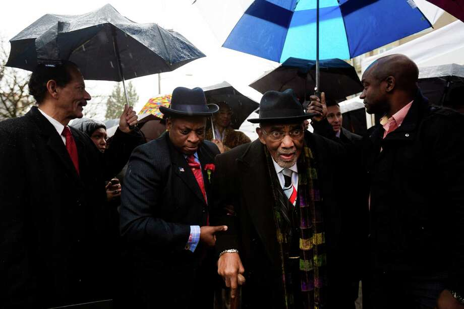 Living legend and leader in the movement for human rights, Rev. Dr. Samuel B. McKinney, center right, makes his way outside to take part in the unveiling of the Rev. Dr. S. McKinney Avenue honorary street sign Sunday, March 2, 2014, at Mt. Zion Baptist Church in Seattle. A portion of 19th Avenue will now be known as Rev. Dr. S. McKinney Ave. Photo: JORDAN STEAD, SEATTLEPI.COM / SEATTLEPI.COM