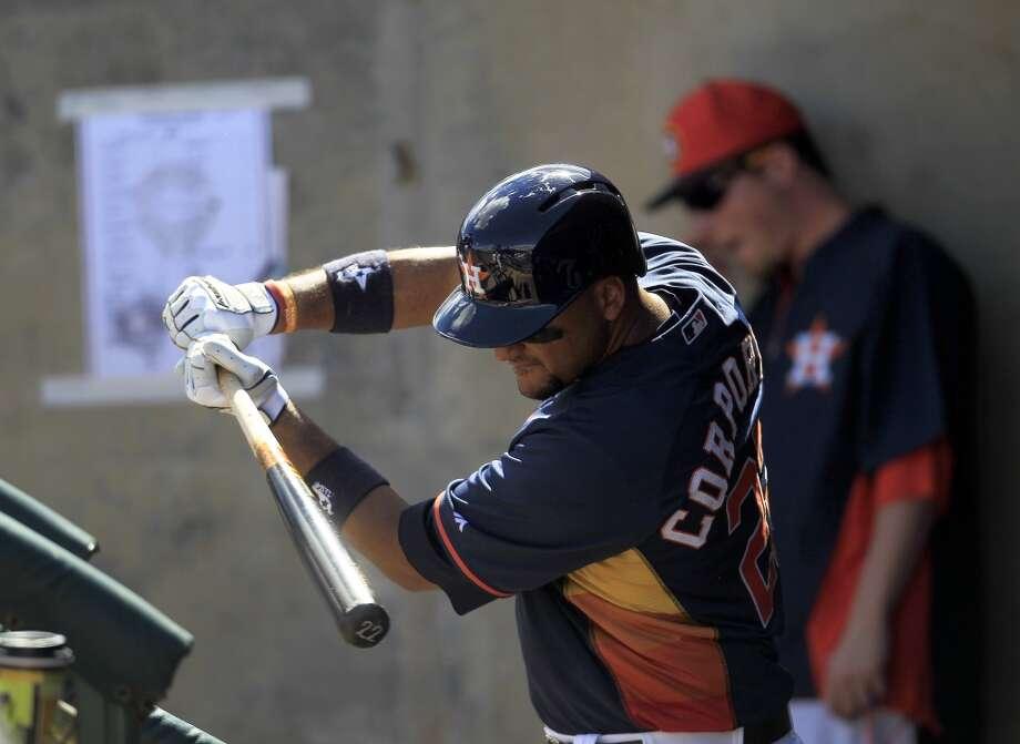 Catcher Carlos Corporan in the dugout in the first inning. Photo: Karen Warren, Houston Chronicle