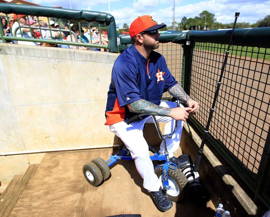 Peter Moylan sits on a tricycle in the dugout as he watches the first inning. Photo: Karen Warren, Houston Chronicle