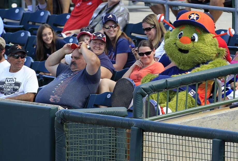 Orbit sits in the stands among the fans. Photo: Karen Warren, Houston Chronicle