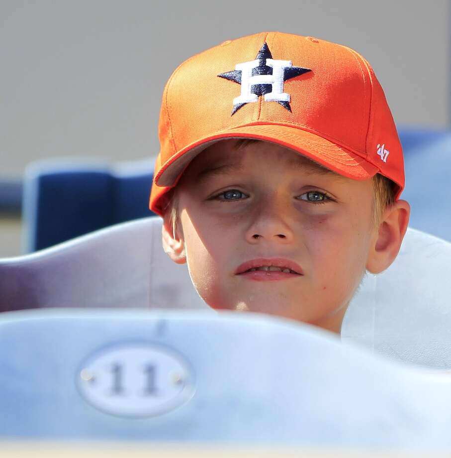 Garrett Carruth, 7, of Orlando, watches his Astros play. Photo: Karen Warren, Houston Chronicle