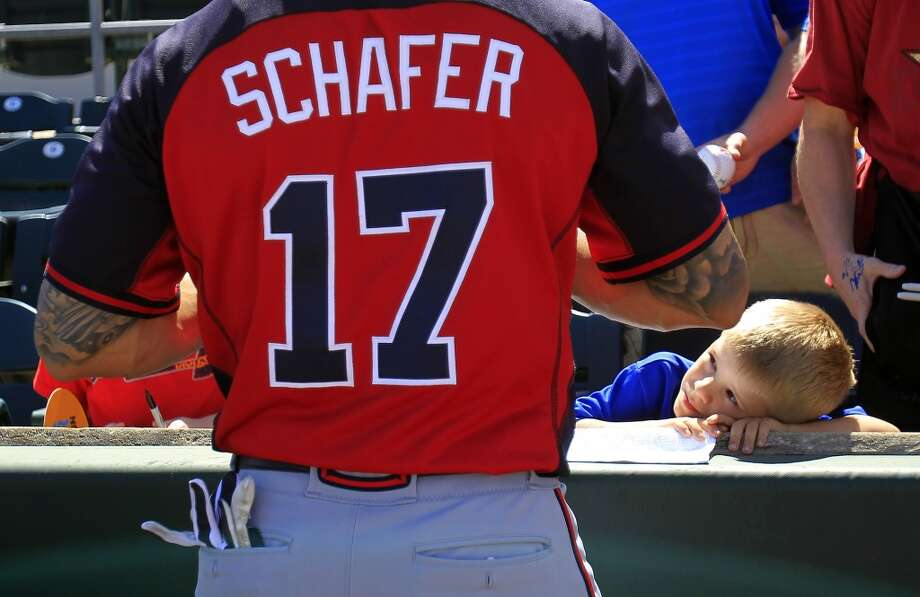 Atlanta's Jordan Schafer signs autographs for fans before the game. Photo: Karen Warren, Houston Chronicle