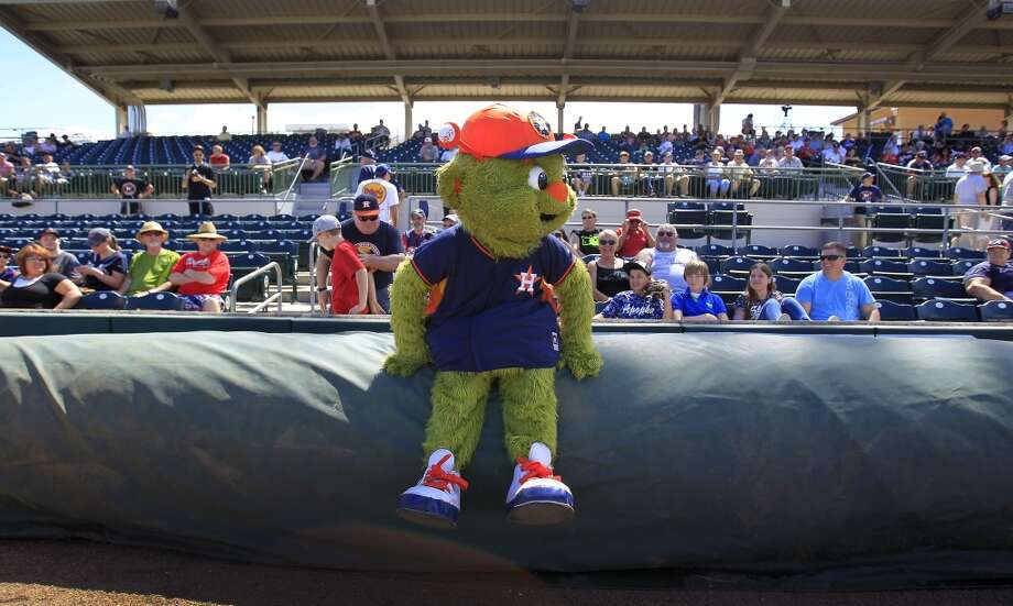 Orbit hangs out with fans before the start of the game. Photo: Karen Warren, Houston Chronicle