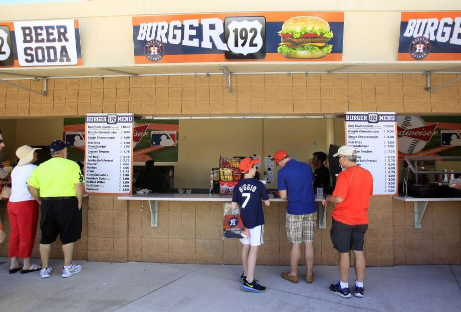 Fans buy lunch at Burger 192 before the start of the game. Photo: Karen Warren, Houston Chronicle