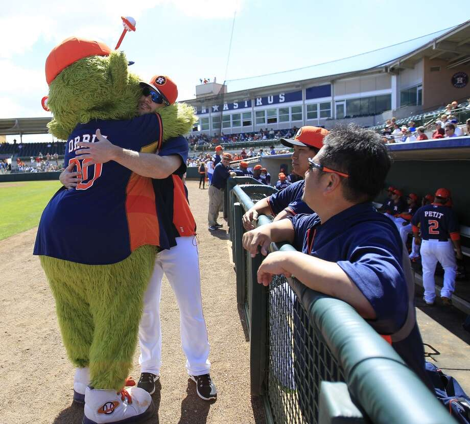 Orbit hugs pitcher Dallas Keuchel before the start of the game. Photo: Karen Warren, Houston Chronicle