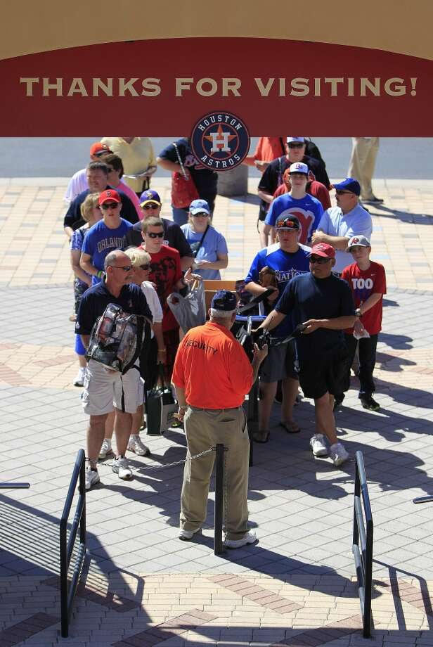Fans line up as the gates open before the start of the game. Photo: Karen Warren, Houston Chronicle