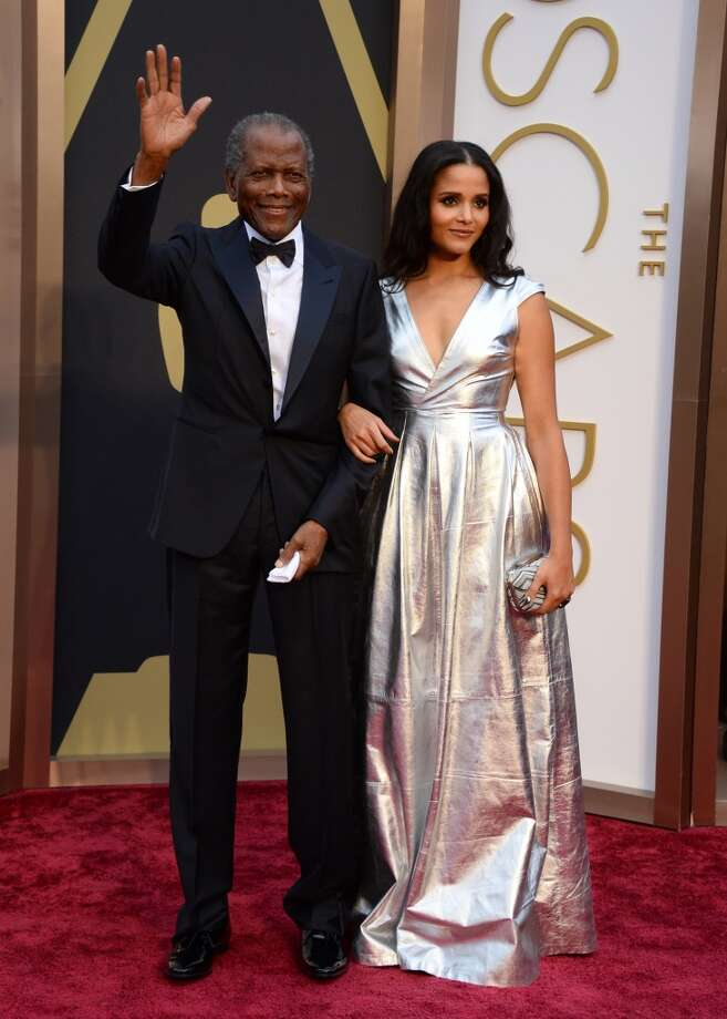 Sidney Poitier, left, and his daughter Sydney Tamiia Poitier arrive at the Oscars on Sunday, March 2, 2014, at the Dolby Theatre in Los Angeles. Photo: Jordan Strauss, Associated Press