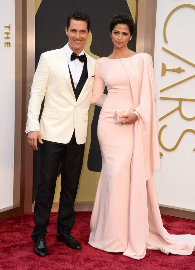 Matthew McConaughey, left, and Camila Alves arrive at the Oscars on Sunday, March 2, 2014, at the Dolby Theatre in Los Angeles. Photo: Jordan Strauss, Associated Press