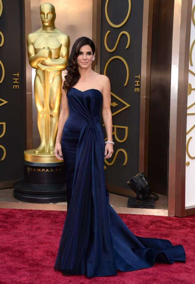 Sandra Bullock arrives at the Oscars on Sunday, March 2, 2014, at the Dolby Theatre in Los Angeles. Photo: Jordan Strauss, Associated Press
