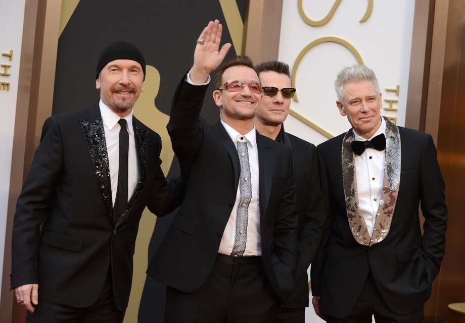 The Edge, from left, Bono, Larry Mullen, Jr., and Adam Clayton of U2 arrive at the Oscars on Sunday, March 2, 2014, at the Dolby Theatre in Los Angeles. Photo: Jordan Strauss, Associated Press