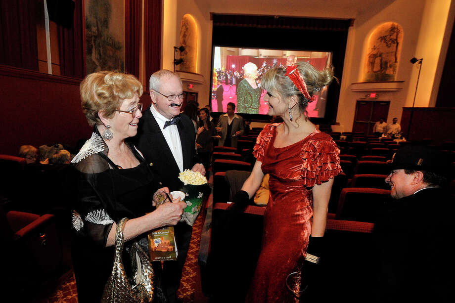 Gerry Boyle and his wife, Barbara, left, greet Shauna Long and her date Pierre Ratté as movie stars are interviewed on the red carpet on the screen in the background during the Avon Oscar Night Party at the Avon Theatre in Stamford, Conn., on Sunday, March 2, 2014. People were asked to come dressed in period attire from 1939, the year the Avon Theatre opened on Bedford Street in Stamford. Photo: Jason Rearick / Stamford Advocate