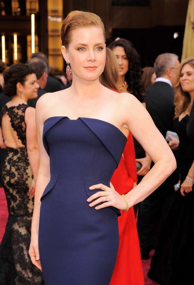 Best Actress nominee Amy Adams wears a stunning dark blue dress to the Oscars. Photo: Chris Pizzello, Associated Press