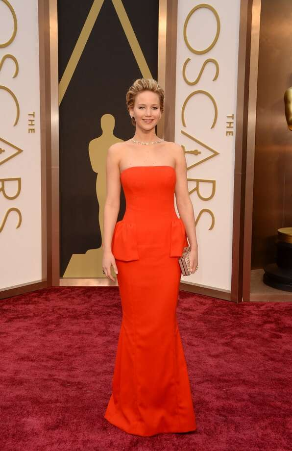Jennifer Lawrence's bright red dress  featured peplum detail. Photo: Jason Merritt, Getty Images